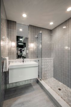 Obsessed with subway tile but want to switch things up a bit? Try a vertical lay. We love how tall the ceilings appear. #TheTileShop #NeutralSpaces