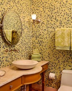 The colorful powder room has floor to ceiling penny round tiles. Vanity: custom by McGuire. Stone sink: Ann Sacks. Tile and plumbing: Waterworks. Photo by Jeff Garland. Kathleen McGovern Studio of Interior Design Kathleen McGovern - Grosse Pte Park, MI