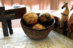 This handmade African basket is perfect for adding an international and homemade touch to your home decor. ...
