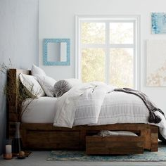 Bedroom with a reclaimed wood storage bed by West Elm