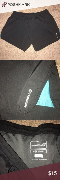 Merrell Running shorts size large Black EUC Great pair of Merrell Black running shorts size large! They have underwear built in! Black with teal accent on side! EUC with Optiwick Merrell Shorts