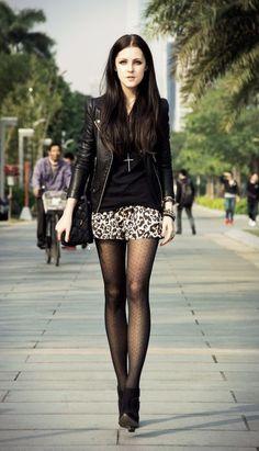 Leopard print shorts, black booties, pattern tights