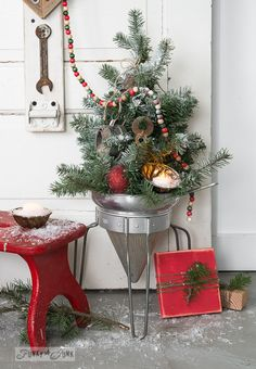 9 - Faux to real mini Christmas tree in a strainer on FunkyJunkInteriors.net #12days72ideas