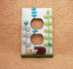 Jamie Hedgehog -  Green, Turquoise, and Grey Outlet or Lightswitch Cover, via Etsy.