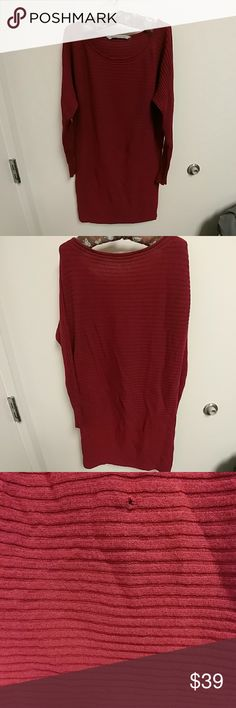Athleta cranberry ribbed knit sweater dress Beautiful cranberry horizontal ribbed knit sweater dress by Athleta. In 100% merino extra fine wool, this sweater dress is crazy soft & comfortable. Features long sleeves and a rolled scoop neckline.  PLEASE NOTE: This dress is in very good condition EXCEPT for 2 small holes (see picture #3 for details.) This should be an easy repair for anyone with sewing skills (something I woefully lack.) Athleta Dresses