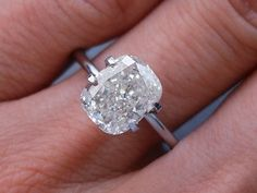 cushion cut engagement ring. Cool setting. Band needs more glam