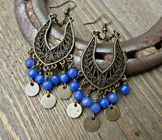 Blue stone and bronze metal, chain and round charm dangle earrings.