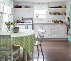 I love white kitchens with pops of color.