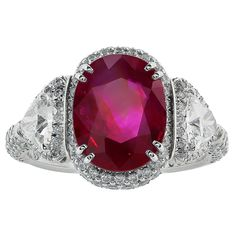 4.13 Carat No Heat Burma Ruby Ring. Rare custom made natural unheated Burma ruby 3 stone ring having a total weight of 4.13 carats and 2 Trillion diamonds having a total weight of 1.60 carats set in a platinum mounting. 21st century