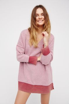 All About It Top   Dreamy oversized V-neck sweatshirt with a fuzzy inside-out bodice and reverse trims.