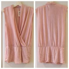 Cache Lt. Pink Shimmering Sleeveless Tunic🔴SALE💲 -New with Tags,  -This stunning light pink shimmering blouse is perfect for the holidays 🎉.  -Very sexy low V-Neck  right side overlapping the left side,    -Size XL.   -This great blouse was bought at Cache. Cache Tops Blouses