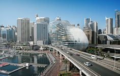 The modified proposal for the redevelopment of the IMAX theatre site in Sydney's Darling Harbour, designed by Hassell, has been recommended for approval Sydney Skyline, Sydney City, New York Skyline, Unique Architecture, Landscape Architecture, Cathedral School, Kent Street, Glass Building, Australia