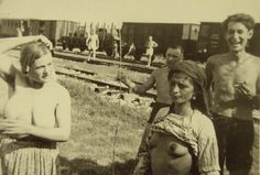 Gypsy women photographed by the Germans during a stop on the way.