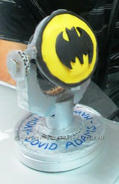 Coolest Batman Projector Cupcake... This website is the Pinterest of birthday cake ideas