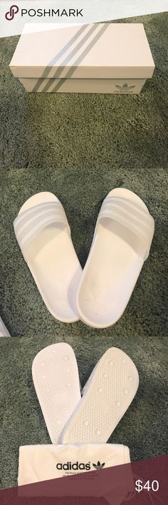 Adidas slides Brand new white/gel adidas slides. These are a size 7 but fit like a size 8. They have tiny B's engraved in the inside heel. Almost unnoticeable if the letter B has no significance to you. Shoes Flats & Loafers