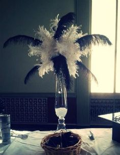 Feather centerpieces on pinterest ostrich feather centerpieces
