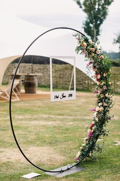 Wedding decorations - A perfect example of the Moon Arch dressed with a half circle of foliage and flowers Finished with the personalised polaroid frame, perfect for catching those funny photos of your friends and family Engagement Decorations, Wedding Ceremony Decorations, Decor Wedding, Decoration Buffet, Room Decorations, Flower Decorations, White Wedding Arch, Moon Wedding, Reception Stage Decor