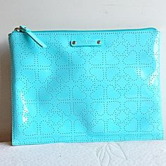 NWOT KATE SPADE METRO ADRIATIC BLUE LARGE POUCH 100% guaranteed authentic. 9.5 X 7 1/4 Retail Price:  $78.00 Style No.:  WLRU1441 Color: Adriatic Blue Zippered Closure Tan Interior Lining with 2 slip pockets NO TRADES OR QUESTION COMMENTS FROM NON SERIOUS BUYERSDO NOT BUNDLE UNLESS YOU INTEND TO BUYDO NOT LOWBALL kate spade Bags Cosmetic Bags & Cases