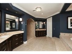 Dark Blue and White Master Bathroom - Aqualane Shores in Naples, Fl never thought about this as a bathroom color, in love!!