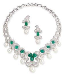 A DIAMOND, EMERALD AND CULTURED PEARL NECKLACE AND EAR PENDANTS, BY DAVID MORRIS The necklace designed as the pavé-set diamond foliate panels with cabochon emerald detail suspending a graduated line of cultured pearls, ear pendants en suite