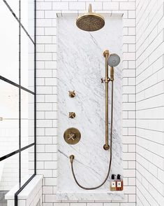 Marble inset with shower fixtures surrounded by Subway tile. Gorgeous bathroom inspiration with white subway tile Bad Inspiration, Bathroom Inspiration, Black White Bathrooms, Bathroom Black, Shower Storage, Shower Shelves, Shower Fixtures, Brass Bathroom Fixtures, Bathroom Hardware