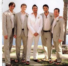 Michael stayed cool in a white Prada suit with a white button-up shirt. The four groomsmen wore textured, stripe cotton suits and white shirts from Club Monaco. All of the guys accessorized with brown sandals and white orchid boutonnieres on their lapels.