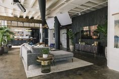 Tour the Queer Eye loft space in Kansas City outfitted exclusively by West Elm. Fab Five, West Elm, Blue Velvet Accent Chair, Kansas City Skyline, Casa Loft, Industrial Loft, Vintage Industrial, Loft Spaces, Loft Apartments