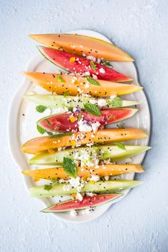 We've been eating this non-stop during the heat wave! This Mint Feta Lime Melon Salad Recipe is beyond easy and quick to prep. This juicy fruit salad is the perfect sweet and savory starter for any gathering.