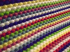 Free Crochet Bobble Blanket Pattern- Also a video on the bobble stitch, which you need to make this striped blanket.