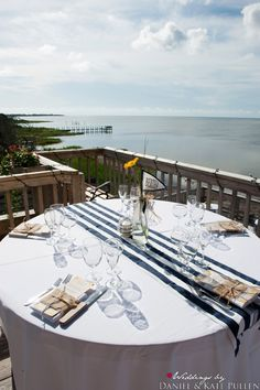 Beautiful waterfront view for this nautical decor.: Abby & Scott had an classic and elegant maritime theme to their wedding at the Inn on the Pamlico Sound in Buxton