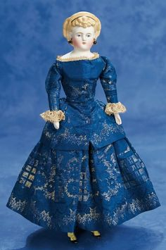 Petite German Bisque Doll with Fancily-Sculpted Hair and Yellow Boots, original costume, circa 1875