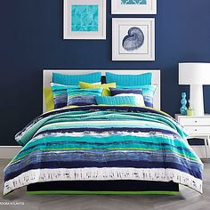 Brighten up your bedroom with the lively J by J. Queen New York Cordoba Comforter Set. Painted in a watercolor fashion with vivid horizontal stripes, the colorful bedding instantly brings a contemporary look to any room's décor.