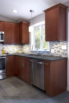 Kitchen Design Ideas With Cherry Cabinets gray wood floors, warm cherry cabinets, white counters