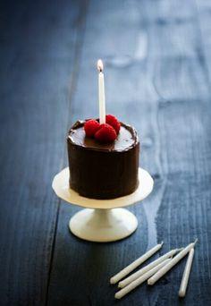 Chocolate raspberry mini birthday cake for one on mini cake stand