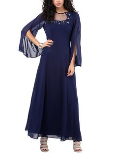 Turn heads at your next special event in this gorgeous navy blue gown from Red Couture. The cut-out detailing at the round neckline is embellished with antique silver metal looking stones all around the neck and slit bell sleeves create an enchanting look. The full-length A-line gown creates a flowing and elegant silhouette.