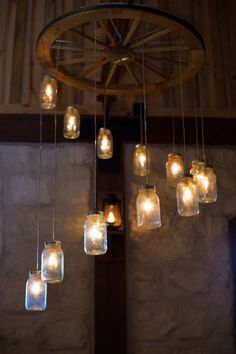country wedding decorations with mason jars / http://www.deerpearlflowers.com/rustic-country-wagon-wheel-wedding-ideas/2/