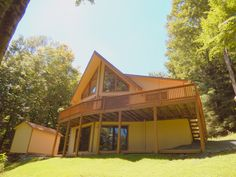 SOLD Location is King! Classic Prow front Cathedral Glass Chalet will capture your heart and spirit. Find yourself relaxing on the sun deck overlooking Briarwood Nature Preserve with mountain Views in Tanglwood lakes.