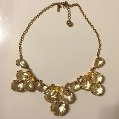 Kate spade gold statement necklace Kate spade gold statement necklace worn a few time but still in great condition gold with goldfish tone stones kate spade Jewelry Necklaces