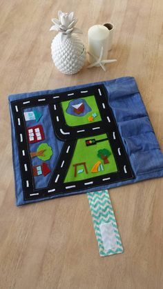 Play & Go Roll up Car Mat  Gorgeous handmade roll up play mat.  Made by me, a mummy of two boys, to keep them quiet when were out and about! Perfect to whip out at appointments and in waiting rooms when quiet play is a must.  This mat has a cute little town with Park, houses, office building, trees, pond, and 5 Garages of varying size to fit different size vehicles. Smaller vehicles (matchbox/hotwheels) or a larger vehicle such as a larger Pixar Lightning Mcqueen, fisher Price etc. The very…