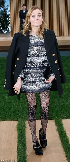 Fashion forward: Diane Kruger looked stunning in a printed shift dress, which she teamed with the lace tights from the Chanel Art's de Metiers show in Rome last year