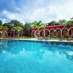 Offering an outdoor swimming pool and a restaurant, Hotel Hacienda Ticum is located 5 mi from Tixkokob town center. Outdoor Swimming Pool, Swimming Pools, Mayan History, Spanish Haciendas, Hotels, I Want To Travel, Merida, Front Desk, Terrace