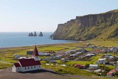 The small town of Vik is located in a scenic setting with a view to the Reynisdrangar sea stacks (South Extreme Iceland)
