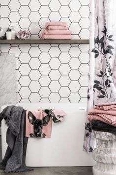 Black and white bathroom with blush and grey towels!