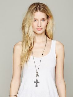 Pretty hippy chic cross necklace. Free People Charmed Lariot Pendant, $38.00