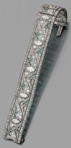 An Art Deco platinum, diamond and emerald bracelet, circa 1930. #ArtDeco #bracelet