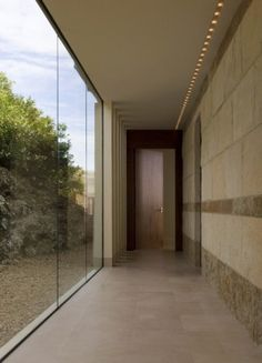 Connect your garage or guest house to the main house with a glass walled walkway. Love it for the experience!