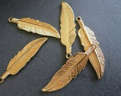 Hey, I found this really awesome Etsy listing at https://www.etsy.com/listing/192383279/12pcs-gold-feather-charm-pendant-beads