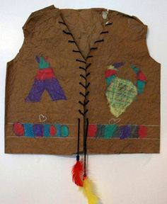 Kennedy615's art on Artsonia First Grade's Native Vests were made with large grocery bags. Students cut out the pre-drawn pattern on the grocery bag. They softened the bag using water and repeated squeezing and unfolding. First they drew a border around the bottom. Using construction paper crayons they added a pattern, and native symbols to the front of the vest. Next they used yarn to sew around the edges of the vest and finished by attaching beads and feathers.