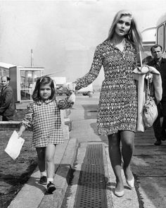 Carol with her daughter while wearing an adorable printed dress.  #modcloth #styleicon
