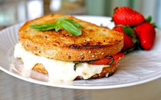 Caprese Grilled Cheese    2 Slices sourdough bread   1/2 cup shredded mozzarella cheese  Fresh basil, chopped  A few slices tomatoes  Butter  Garlic powder